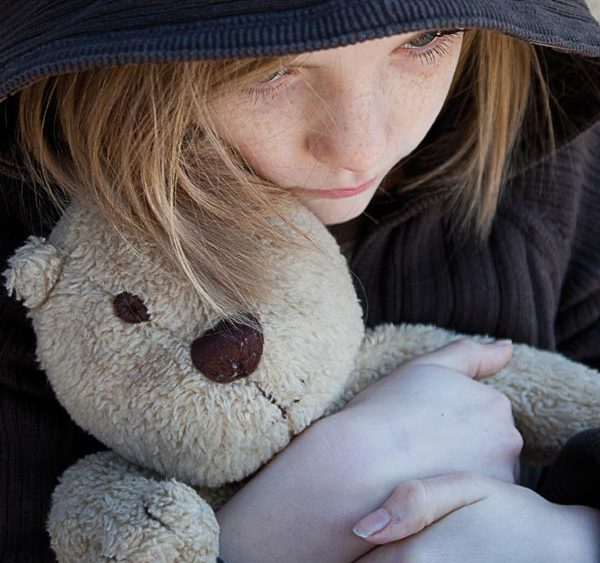 Picture of a young girl holding a teddybear