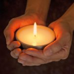 Picture of hands holding a candle