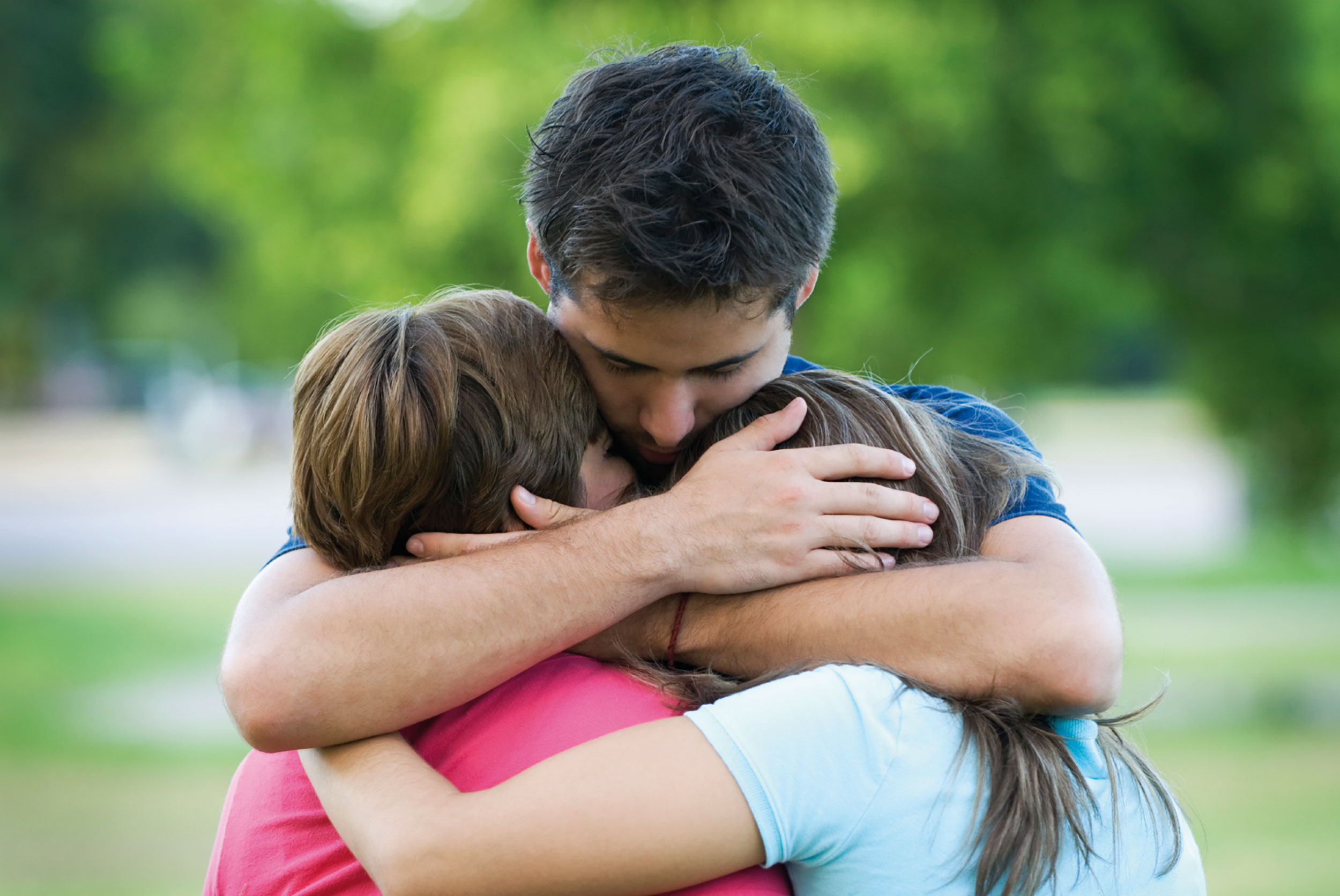 Picture of a bereaved family hugging